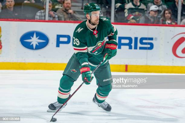 Nate Prosser of the Minnesota Wild handles the puck against the Calgary Flames during the game at the Xcel Energy Center on January 9 2018 in St Paul...