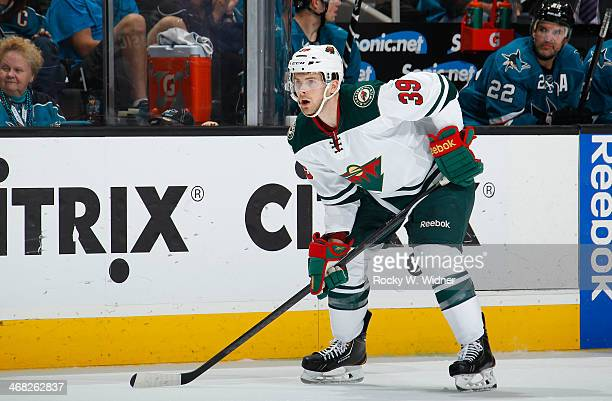 Nate Prosser of the Minnesota Wild in a faceoff against the San Jose Sharks at SAP Center on January 25 2014 in San Jose California