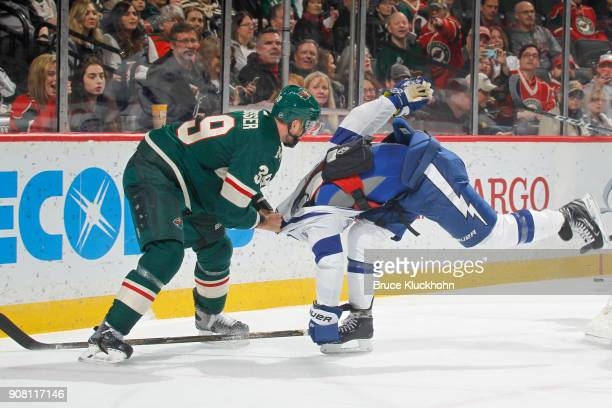 Nate Prosser of the Minnesota Wild is called for roughing against Ryan Callahan of the Tampa Bay Lightning during the game at the Xcel Energy Center...