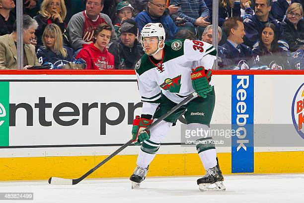 Nate Prosser of the Minnesota Wild keeps an eye on the play during first period action against the Winnipeg Jets at the MTS Centre on April 7 2014 in...