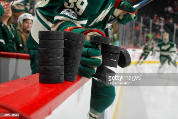 Nate Prosser of the Minnesota Wild knocks the warm up pucks onto the ice prior to the game against the Chicago Blackhawks on February 21 2017 at the...