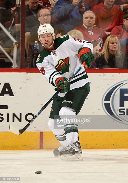 Nate Prosser of the Minnesota Wild passes the puck against the Arizona Coyotes at Gila River Arena on December 11 2015 in Glendale Arizona