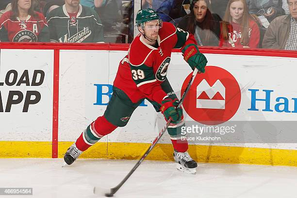 Nate Prosser of the Minnesota Wild passes the puck against the Anaheim Ducks during the game on March 13 2015 at the Xcel Energy Center in St Paul...