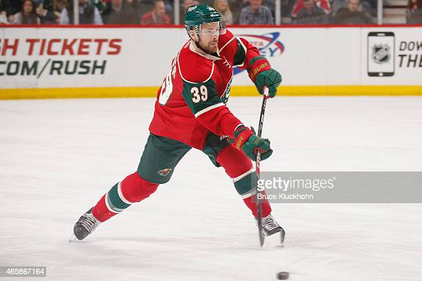 Nate Prosser of the Minnesota Wild passes the puck against the Ottawa Senators during the game on March 3 2015 at the Xcel Energy Center in St Paul...
