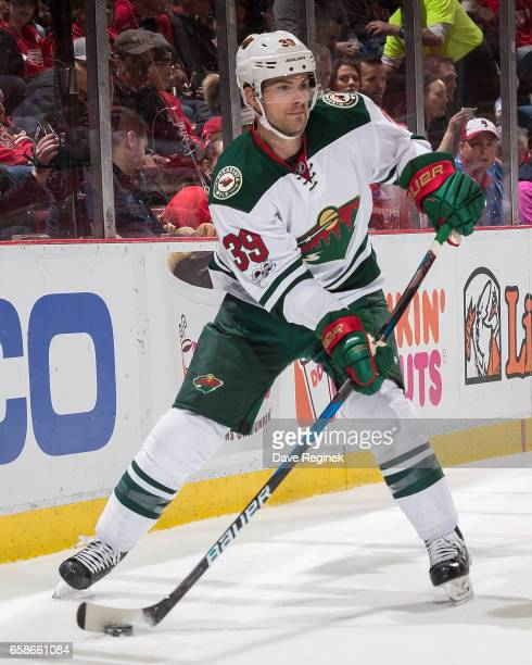 Nate Prosser of the Minnesota Wild passes the puck against the Detroit Red Wings during an NHL game at Joe Louis Arena on March 26 2017 in Detroit...
