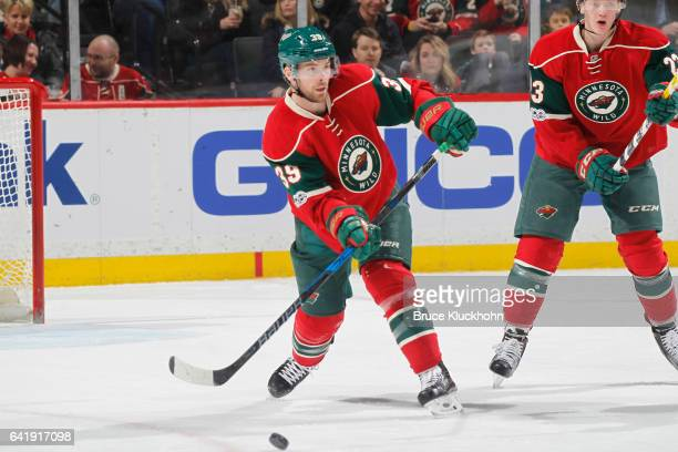 Nate Prosser of the Minnesota Wild passes the puck against the Tampa Bay Lightning during the game on February 10 2017 at the Xcel Energy Center in...