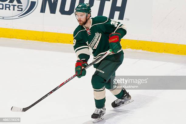 Nate Prosser of the Minnesota Wild passes the puck against the Colorado Avalanche during the game on March 8 2015 at the Xcel Energy Center in St...