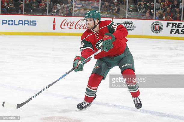 Nate Prosser of the Minnesota Wild passes the puck against the Arizona Coyotes during the game on January 19 2017 at the Xcel Energy Center in St...