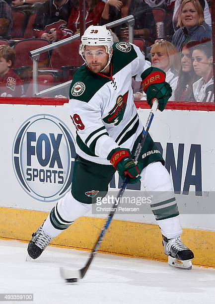 Nate Prosser of the Minnesota Wild passes the puck during the NHL game against the Arizona Coyotes at Gila River Arena on October 15 2015 in Glendale...