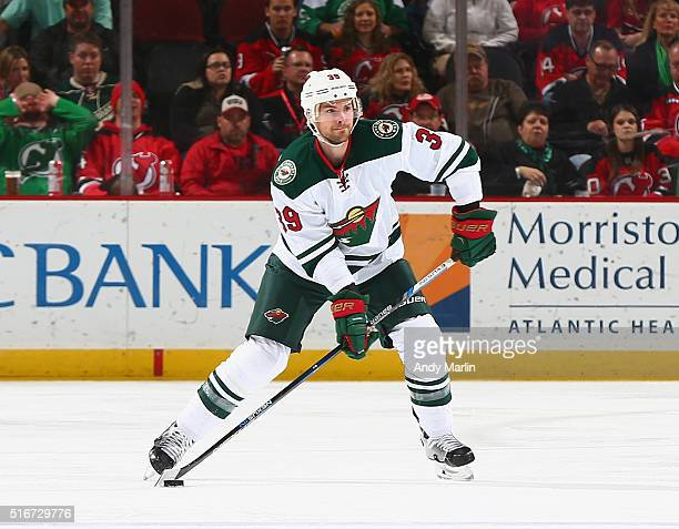 Nate Prosser of the Minnesota Wild plays the puck during the game against the New Jersey Devils at the Prudential Center on March 17 2016 in Newark...