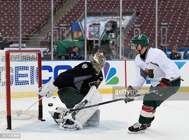 Nate Prosser of the Minnesota Wild shoot the puck against teammate Darcy Kuemper during practice day at the 2016 Coors Light Stadium Series on...