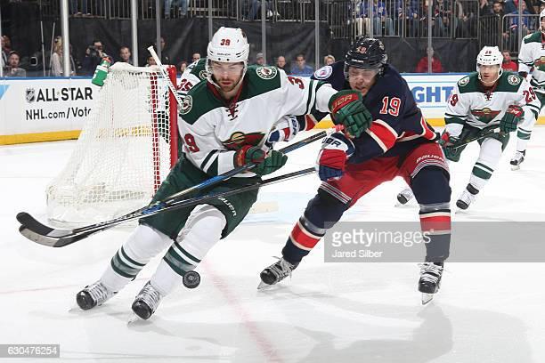 Nate Prosser of the Minnesota Wild skates against Jesper Fast of the New York Rangers at Madison Square Garden on December 23 2016 in New York City