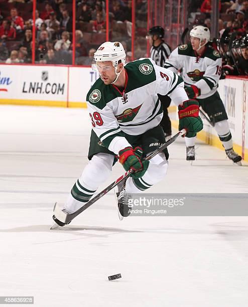 Nate Prosser of the Minnesota Wild skates against the Ottawa Senators at Canadian Tire Centre on November 6 2014 in Ottawa Ontario Canada