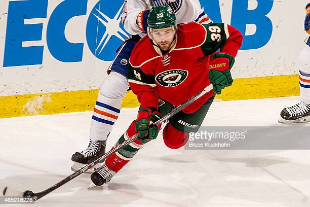 Nate Prosser of the Minnesota Wild skates with the puck against the Edmonton Oilers during the game on February 24 2015 at the Xcel Energy Center in...