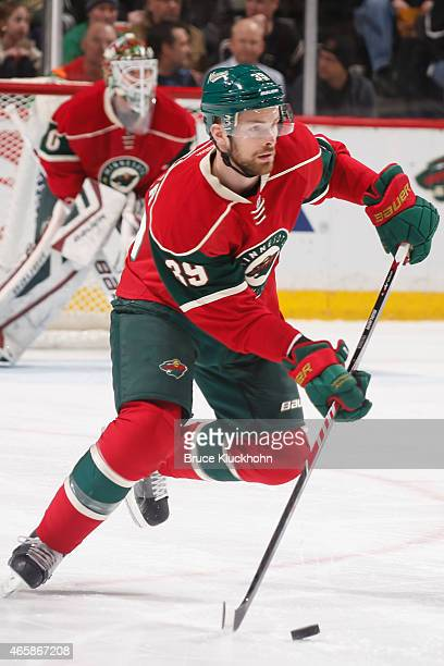 Nate Prosser of the Minnesota Wild skates with the puck against the Ottawa Senators during the game on March 3 2015 at the Xcel Energy Center in St...