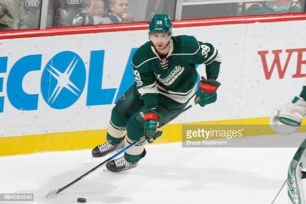 Nate Prosser of the Minnesota Wild skates with the puck against the Washington Capitals during the game on March 28 2017 at the Xcel Energy Center in...