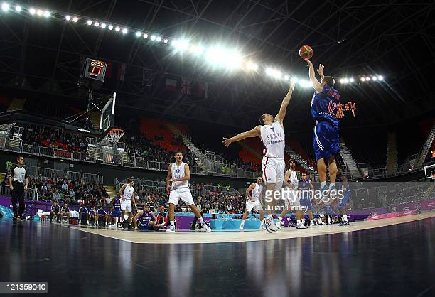 Nate Reinking of Great Britain shoots during the match between Great Britain and Serbia at the Basketball Arena on August 18 2011 in London England