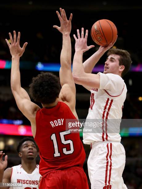 Nate Reuvers of the Wisconsin Badgers attempts a shot while being guarded by Isaiah Roby of the Nebraska Huskers in the second half during the...
