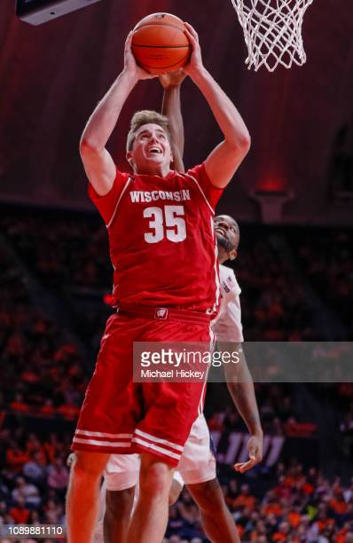 Nate Reuvers of the Wisconsin Badgers shoots the ball during the game against the Illinois Fighting Illini at State Farm Center on January 23 2019 in...