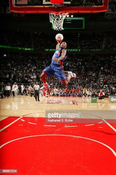 Nate Robinson New York of the attempts a dunk during the Sprite Rising Stars Slam Dunk Contest on AllStar Saturday Night during 2006 AllStar Weekend...