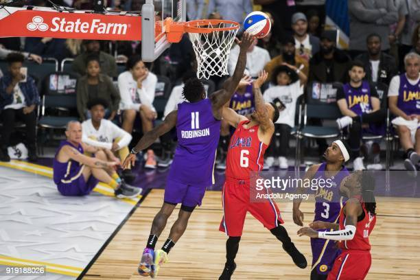 Nate Robinson of Team Lakers blocks Andre De Grasse of Team Clippers during the 2018 NBA AllStar Celebrity Game as part of AllStar Weekend at the Los...