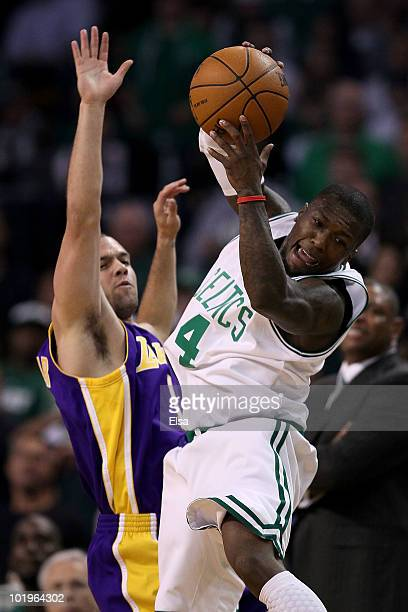 Nate Robinson of the Boston Celltics grabs the ball over Jordan Farmar the Los Angeles Lakers during Game Four of the 2010 NBA Finals on June 10 2010...