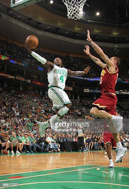 Nate Robinson of the Boston Celtics shoots against Delonte West of the Cleveland Cavaliers in Game Three of the Eastern Conference Semifinals during...
