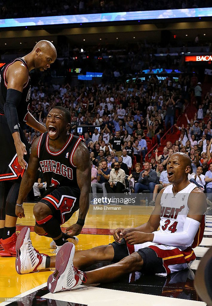 Nate Robinson #2 of the Chicago Bulls and Ray Allen #34 of the Miami Heat react to a play during a game at AmericanAirlines Arena on January 4, 2013 in Miami, Florida.