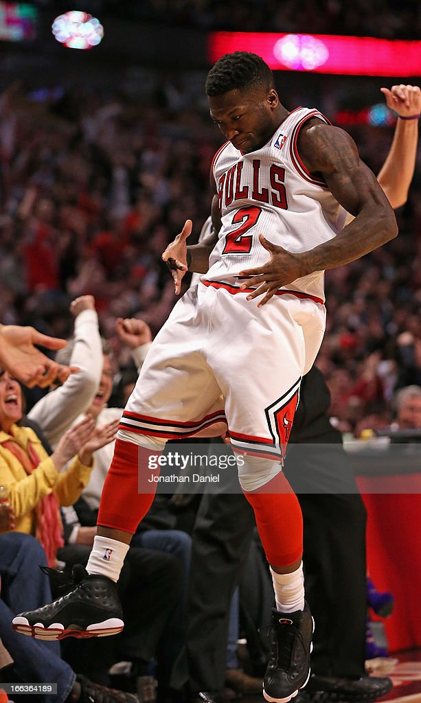 Nate Robinson #2 of the Chicago Bulls celebrates hitting a three-point shot against the New York Knicks at the United Center on April 11, 2013 in Chicago, Illinois. The Bulls defeated the Knicks 118-111 in overtime.