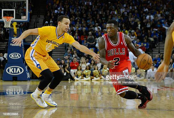 a3342cc01 Nate Robinson of the Chicago Bulls drives on Stephen Curry of the Golden  State Warriors at