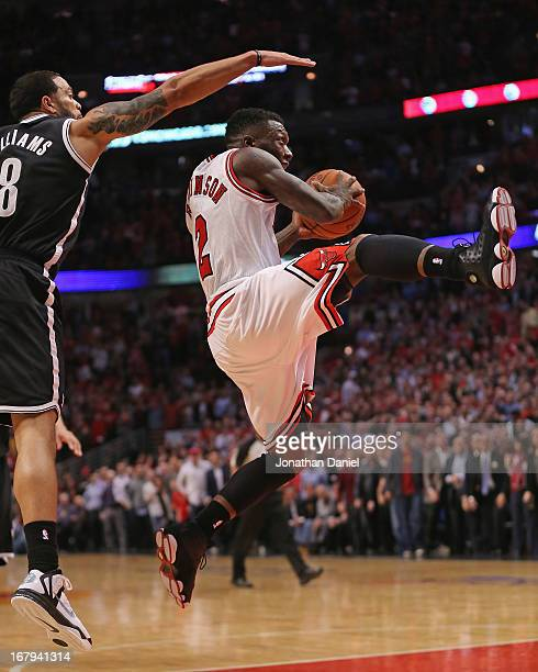 Nate Robinson of the Chicago Bulls drives past Deron Williams of the Brooklyn Nets in Game Six of the Eastern Conference Quarterfinals during the...
