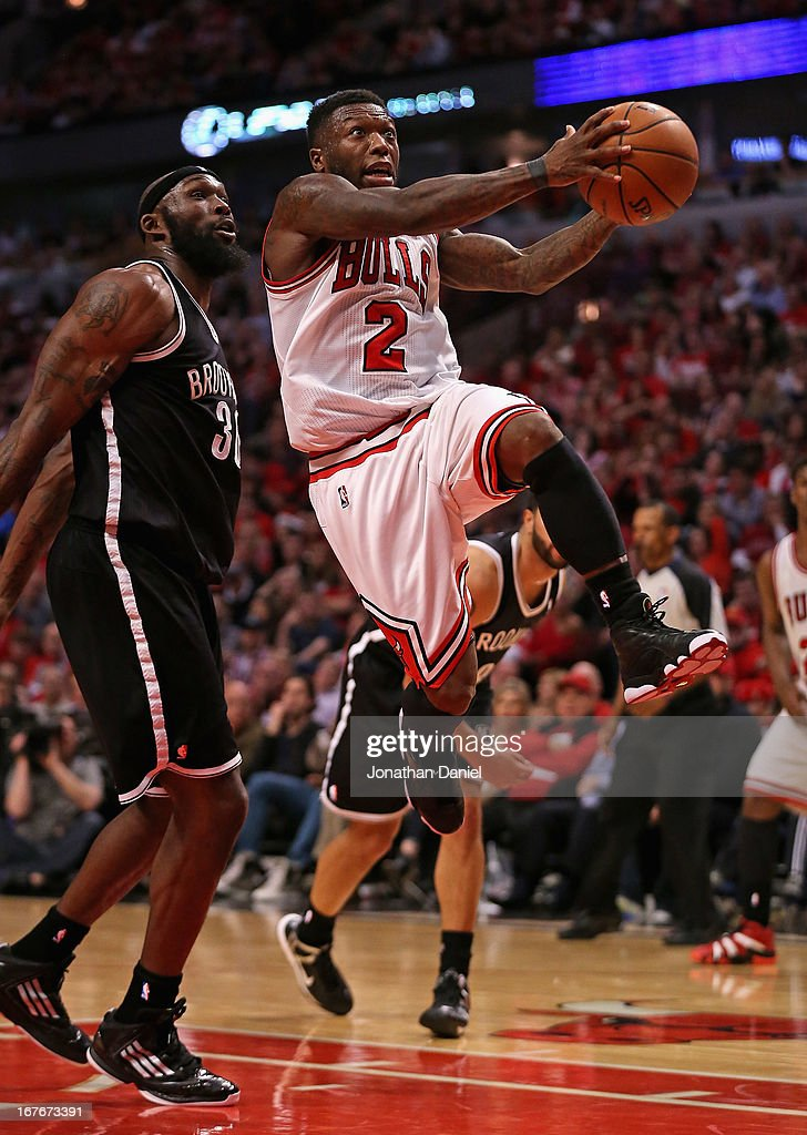 Nate Robinson #2 of the Chicago Bulls drives to the basket past Reggie Evans #30 of the Brooklyn Nets in Game Five of the Eastern Conference Quarterfinals in the 2013 NBA Playoffs at the United Center on April 27, 2013 in Chicago, Illinois. The Bulls defeated the Nets 142-134 in triple overtime.