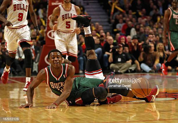 Nate Robinson of the Chicago Bulls falls over Doron Lamb of the Milwaukee Bucks after a battle for the ball at the United Center on November 26 2012...