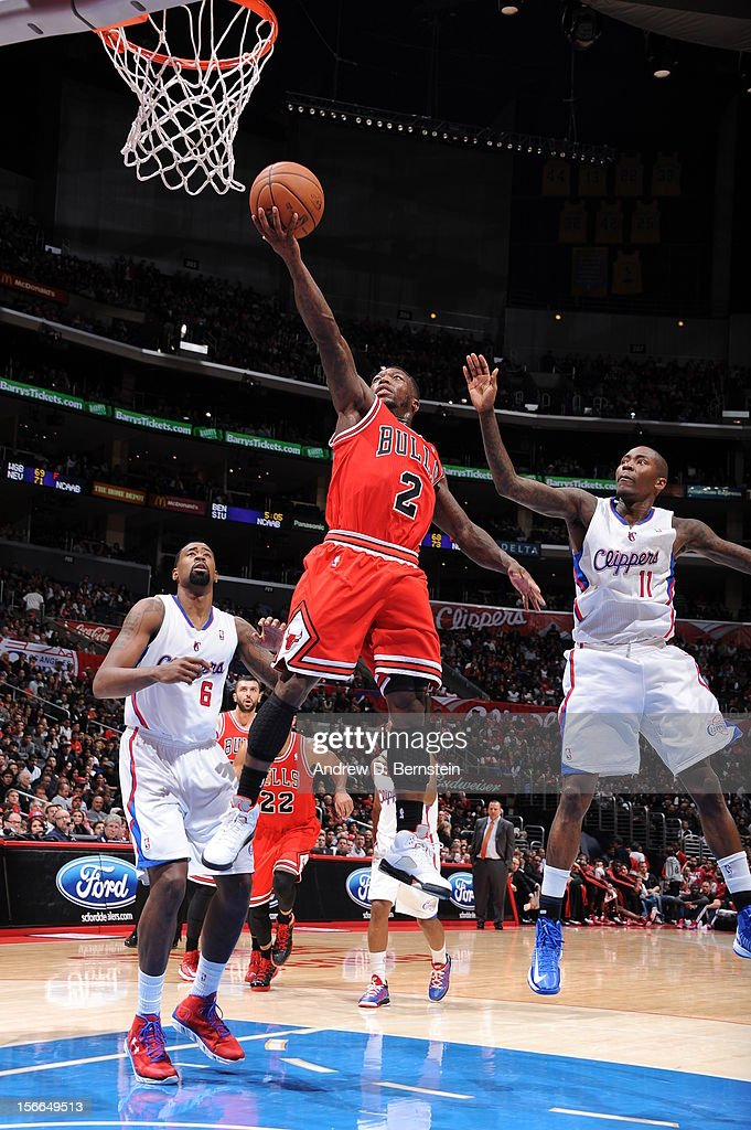 Nate Robinson #2 of the Chicago Bulls goes up for a layup against DeAndre Jordan #6 and Jamal Crawford #11 of the Los Angeles Clippers at Staples Center on November 17, 2012 in Los Angeles, California.