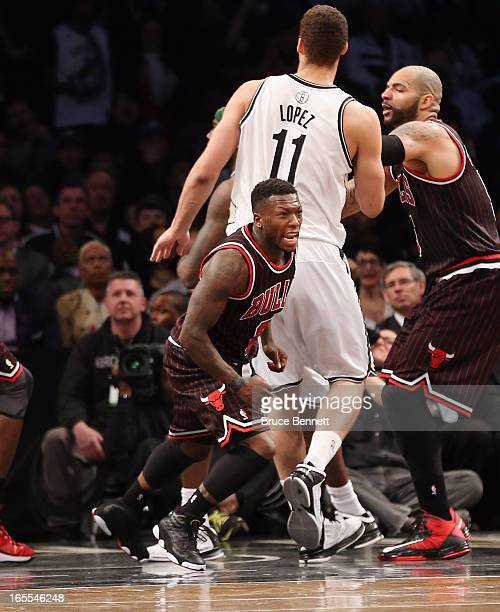 Nate Robinson of the Chicago Bulls hits a basket with 227 second left against the Brooklyn Nets at the Barclays Center on April 4 2013 in New York...
