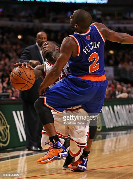 Nate Robinson of the Chicago Bulls is fouled by Raymond Felton of the New York Knicks at the United Center on April 11 2013 in Chicago Illinois The...