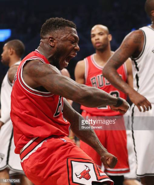 Nate Robinson of the Chicago Bulls sinks a basket and draws a fould against the Brooklyn Nets during Game Five of the Eastern Conference...
