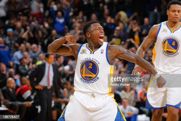 Nate Robinson of the Golden State Warriors celebrates after hitting a big shot against the Miami Heat on January 10 2012 at Oracle Arena in Oakland...