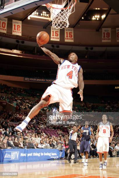 Nate Robinson of the New York Knicks attempts to dunk against the Dallas Mavericks during a preseason game on October 16 2005 at Madison Square...