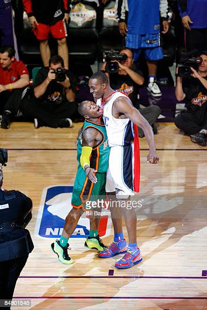 Nate Robinson of the New York Knicks chest bumps Dwight Howard of the Orlando Magic during the Sprite Slam Dunk Contest as part of 2009 NBA AllStar...