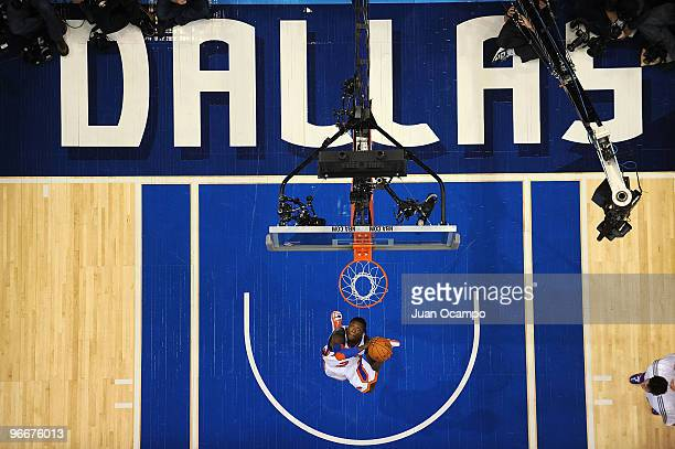 Nate Robinson of the New York Knicks dunks during the Sprite Slam Dunk contest as part of All Star Saturday Night during 2010 NBA All Star Weekend on...