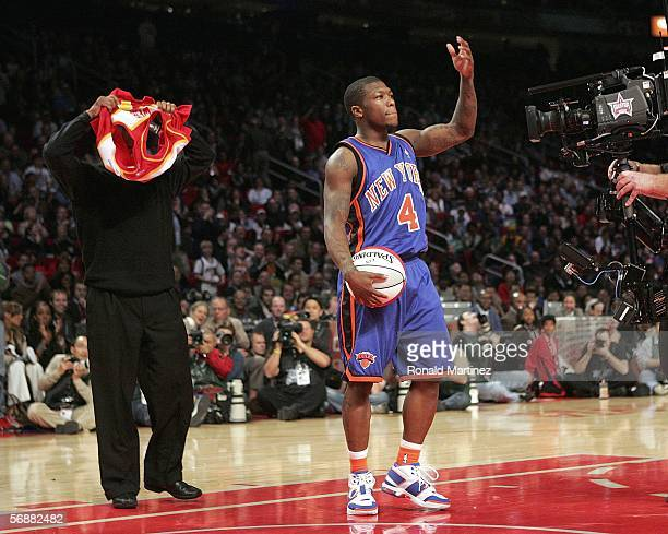 Nate Robinson of the New York Knicks entices the crowd as Spud Webb puts on his Atlanta Hawks jersey from the year he won the dunk contest in the...