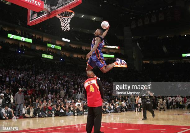 Nate Robinson of the New York Knicks goes up for a dunk over former slam dunk champion Spud Webb in the Sprite Rising Stars Slam Dunk competition...