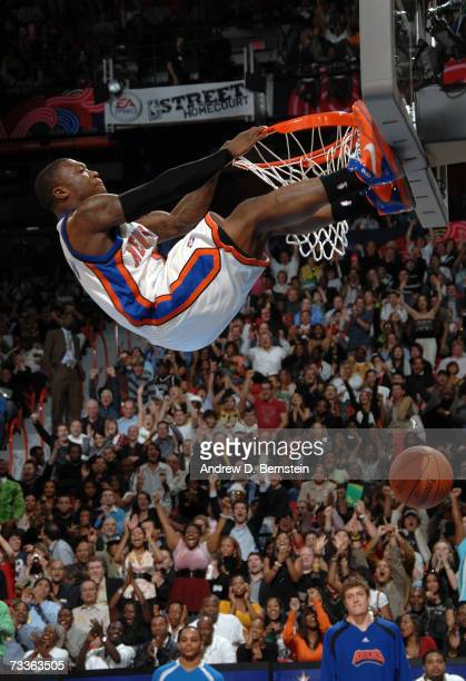 Nate Robinson of the New York Knicks grabs the rim and places his feet on the backboard during the Sprite Slam Dunk Competition at NBA All-Star...