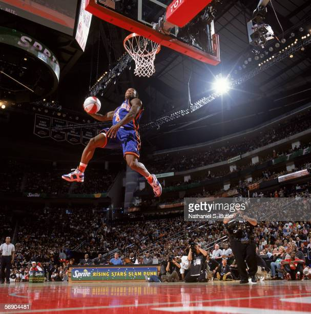 Nate Robinson of the New York Knicks performs a dunk during the Sprite Rising Stars Slam Dunk Contest on AllStar Saturday Night during the 2006...