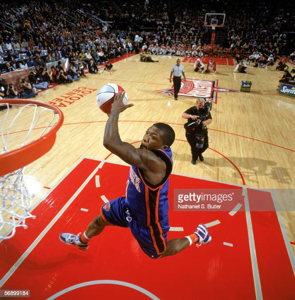 Nate Robinson of the New York Knicks performs a dunks during the Sprite Rising Stars Slam Dunk Contest on AllStar Saturday Night during the 2006...