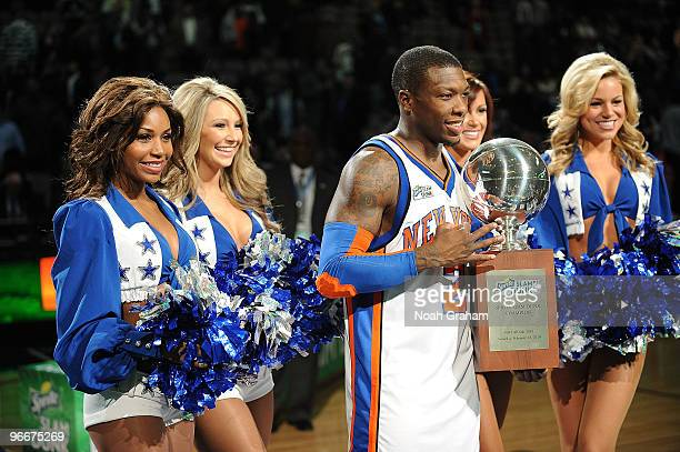Nate Robinson of the New York Knicks poses with his trophy after winning the Sprite Slam Dunk contest as part of All Star Saturday Night during 2010...