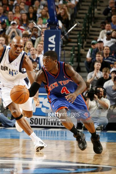 Nate Robinson of the New York Knicks pushes the ball upcourt against the Jerry Stackhouse of the Dallas Mavericks during the game at American...