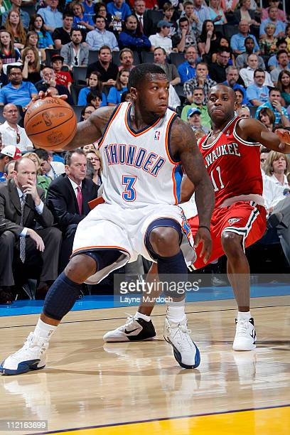 Nate Robinson of the Oklahoma City Thunder drives against Earl Boykins of the Milwaukee Bucks on April 13 2011 at the Oklahoma City Arena in Oklahoma...