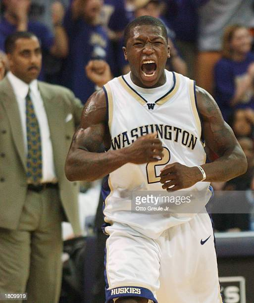 Nate Robinson of the Washington Huskies celebrates near the end of the game against the Oregon Ducks on February 22 2003 at Bank of America Arena in...